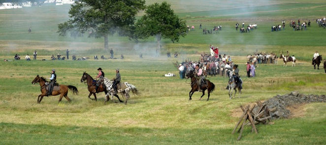Confederate cavalry makes a flanking maneuver at Saturday's battle reenactment (Photo: Peter Roof)